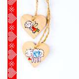 Two wooden hearts on string forming Christmas pattern Royalty Free Stock Photos