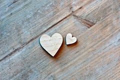 Two Wooden Hearts on Wooden Background Royalty Free Stock Images