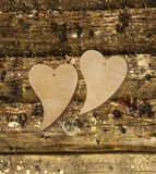 Two wooden hearts on a wooden background royalty free stock photo