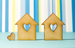 Two wooden houses with hole in the form of heart with little hea Stock Photos