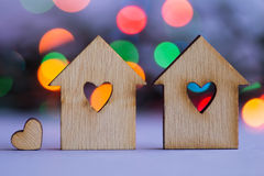 Two wooden houses with hole in the form of heart with little hea Royalty Free Stock Photo
