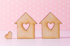 Two wooden houses with hole in the form of heart with little hea Royalty Free Stock Photos