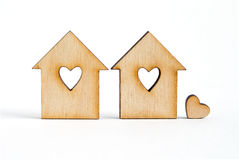 Two wooden houses with hole in the form of heart with little hea Stock Images