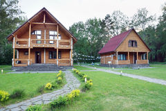 Two Wooden Houses Made of Logs Near of Forest Stock Photos
