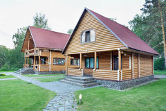 Two Wooden Houses Made of Logs Royalty Free Stock Image
