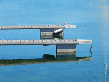 Two wooden landing stages in the harbor Stock Image