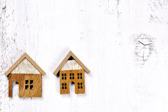 Two wooden little houses - conceptual background Royalty Free Stock Photo
