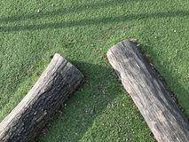 Two wooden Logs. View of two wooden logs in a children playground royalty free stock photo