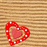 Two wooden love heart in the sea sand Royalty Free Stock Photo
