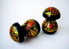 Two wooden mushrooms Khokhloma. Two wooden mushrooms in russian Khokhloma Royalty Free Stock Photo