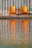 Two wooden Muskoka chairs Stock Image