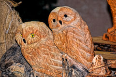 Two wooden owls. Two wooden owls, made by the hand of a master. From afar it seems that they are alive. Christmas market Stock Photography