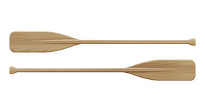 Two wooden paddles. Sport oars. Stock Photos