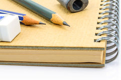 Two Wooden pencil, eraser on notebook. Royalty Free Stock Photography