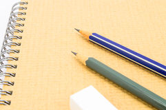 Two Wooden pencil, eraser on notebook. Stock Photography