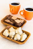 Two wooden plates of halva and waffles with cups of coffee Royalty Free Stock Images