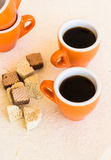 Two wooden plates of halva and waffles with cups of coffee Stock Photos