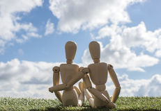 Two wooden puppets as loving couple Stock Images