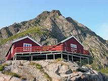 Two wooden red cottage on the mountain Stock Photography