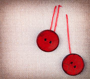Two wooden red sewed buttons Stock Photos