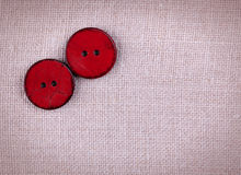 Two wooden red sewed buttons Stock Image