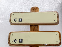 Two wooden signs with indicative arrows Stock Photo