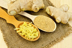Ginger fresh and dried in wooden spoons Royalty Free Stock Photography