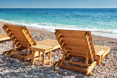 Two wooden sun loungers on Adriatic Sea coast Stock Photo