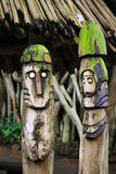 Two wooden totems (idols) near. African village Royalty Free Stock Photo