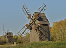 Two wooden wind mills Stock Images