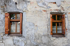 Two wooden windows on an old degraded wall Stock Photo