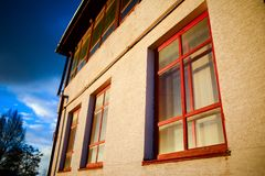 Two wooden windows on the wall royalty free stock photo