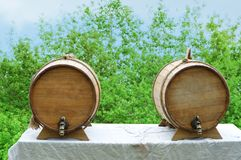Two wooden wine barrels on the table. royalty free stock image