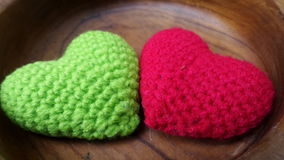 Two wool hearts in one plate Stock Images