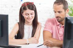 Two work colleague in their office royalty free stock photography