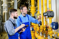 Two worker in industrial plant royalty free stock photos