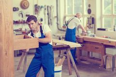 Two worker in a carpenter`s workshop Stock Photo
