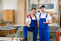 Two worker in a carpenter's workshop Royalty Free Stock Photography