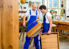 Two worker in a carpenter's workshop Royalty Free Stock Photo