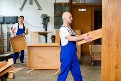 Two worker in a carpenter's workshop Stock Image