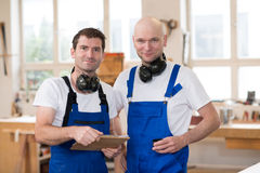 Two worker in a carpenter's workshop Stock Photos