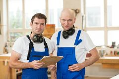 Two worker in a carpenter`s workshop Stock Images