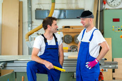 Two worker in a carpenter's workshop Royalty Free Stock Images