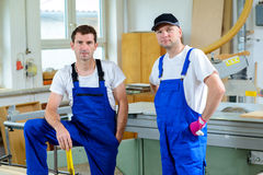 Two worker in a carpenter's workshop Royalty Free Stock Image