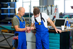 Two worker in factory in conversation Royalty Free Stock Image