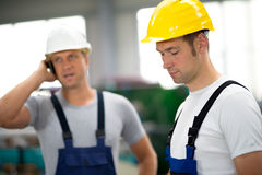 Two worker in factory with hard top Royalty Free Stock Images