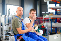 Two worker in factory have a break Royalty Free Stock Photography