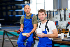 Two worker in factory have a break Stock Photography