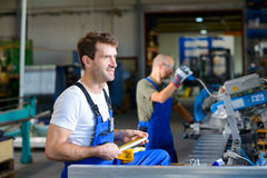 Two worker in factory Royalty Free Stock Image