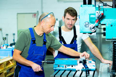 Two worker in factory Royalty Free Stock Photos